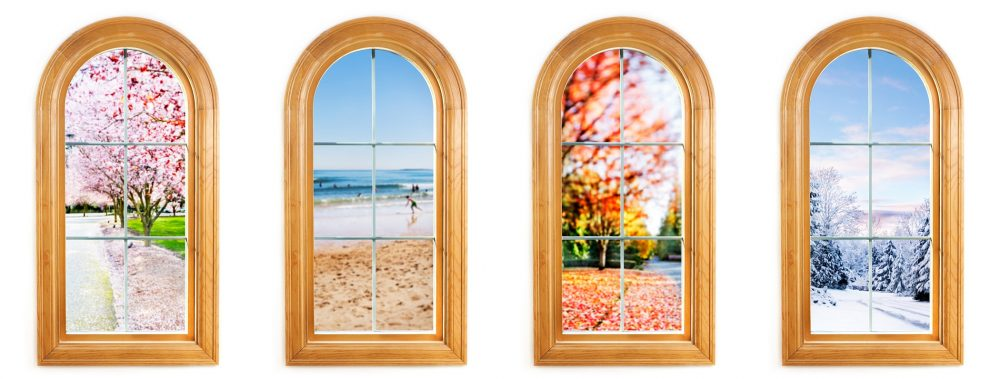Round top window with views of spring, summer, fall and winter